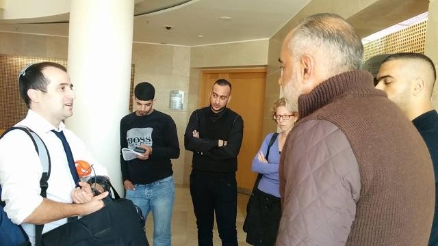 """טאלב אלטורי עם עו""""ד איתי מק בתום הדיון. מתוך דף הפייסבוק של הוועד הציבורי נגד עינויים בישראל."""